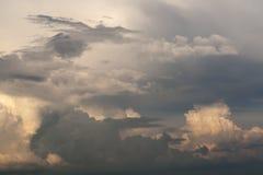 Cumulus clouds in the disturbing, evening sky. Cumulus clouds in the evening sky stock image