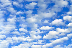 Cumulus clouds fly across the sky Stock Photo