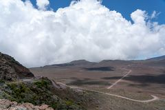 Cumulus clouds form in the trade wind over the road to the volcanic crater Piton de la Fournaise on the island of La Réunion stock photography