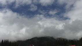 Cumulus clouds formation over the mountains stock video footage