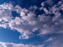 Cumulus clouds gather in the sky before a thunderstorm. Dark sky and thick clouds before a thunderstorm stock images