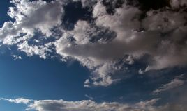 Cumulus clouds gather in the sky before a thunderstorm. Dark sky and thick clouds before a thunderstorm stock image