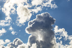 Cumulus Clouds And Grey Storm Clouds Gathering On Blue Sky Stock Photography