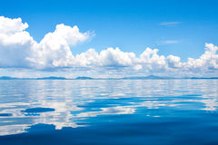 Cumulus clouds in the horizon above tropical isla Stock Photo