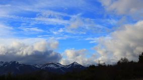 Cumulus clouds moving on pyrenean mountains. Cumulus clouds moving on pyrenean mountain filmed in timelapse, Ariège in Occitnia south of France stock footage