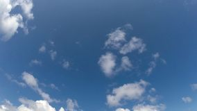 Cumulus. Clouds are moving quickly on a blue background. Taimelaps stock video footage