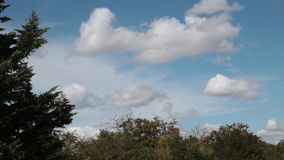 Cumulus clouds moving in the sky filmed in timelapse. Aude in occitanie, France stock video footage