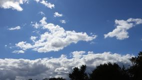 Cumulus clouds moving in sky in timelapse stock footage