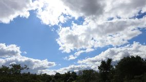 Cumulus clouds moving in sky in timelapse. Cumulus clouds moving in sky filmed in timelapse stock video footage