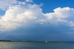 Cumulus clouds over Black sea before the rain. Cumulus clouds over Black sea royalty free stock image