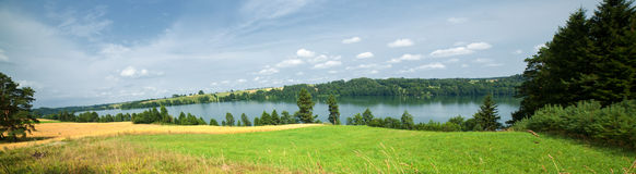 Cumulus Clouds over Lake Stock Photography