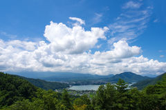 Cumulus Clouds Over a Mountain Lake in Japan Stock Image