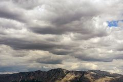 Cumulus clouds over the mountains Royalty Free Stock Photography