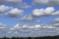 Cumulus clouds over Surrey. England Royalty Free Stock Image