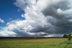 Cumulus clouds over the valleyCumulus thunderstorm clouds over the green fields of Russia Stock Images