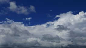 Cumulus clouds parallax time lapse. A time lapse video showing parallax motion and transformation of clouds in great depth. Taken mid day stock video footage