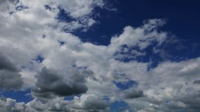 Cumulus clouds parallax time lapse. A time lapse video showing parallax motion and transformation of clouds in great depth. Taken mid day.n stock footage
