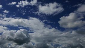 Cumulus clouds parallax time lapse. A time lapse video showing the parallax movement and transformation of cumulus clouds stock footage