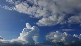 Cumulus clouds parallax time lapse. A time lapse video showing the parallax movement and transformation of cumulus clouds stock video