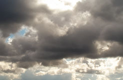 Cumulus clouds. With punched through them the sun Royalty Free Stock Photography