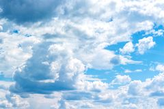 Cumulus clouds in sky royalty free stock photography