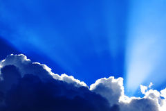 Cumulus clouds with sunbeams. Background of dramatic moody cumulus clouds with sunbeams Royalty Free Stock Image