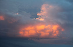 Cumulus clouds at sunset Royalty Free Stock Photos