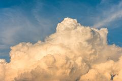 Cumulus clouds at sunset with gradient sky. Royalty Free Stock Photos