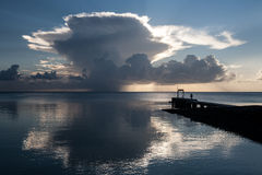 Cumulus Clouds and Sunset. The sunset silhouettes a massive cumulus cloud in the Republic of Palau, Micronesia. This area is a popular destination for scuba Stock Photo