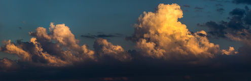 Cumulus clouds on sunset sky. Royalty Free Stock Photography