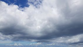 Cumulus Clouds Time Lapse 31. A time lapse video showing movement  and transformation of cumulus clouds stock video footage