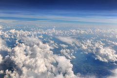 Cumulus and Cumulonimbus Clouds above the Earth Stock Images