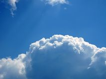 Cumulus curly white clouds on blue sky Royalty Free Stock Photos