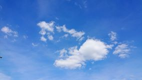 Cumulus humilis clouds. Or fair weather clouds, against a blue sky royalty free stock photography