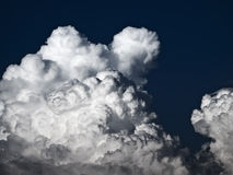 Cumulus and Lenticular. Towering detailed cumulus cloud with lenticular formations Stock Photos