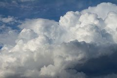 Cumulus nimbus huge in the sky. Cottony clouds that carry a storm stock image