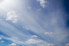 Cumulus and plumose clouds in the blue sky Stock Photos