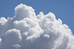 Cumulus Cloud Rising. Cumulus clouds rising in the sky aftrr a rain. Large billowy cloud formation stock photos