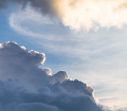 Cumulus sunset clouds with sun setting down, beautiful sky Stock Photos