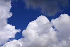 Cumulus white clouds in the blue sky Stock Image