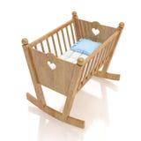 Cuna de madera del bebé con la almohada azul aislada en el fondo blanco Imagen de archivo
