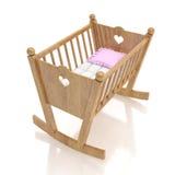 Cuna de madera del bebé con la almohada color de rosa aislada en el fondo blanco Imagen de archivo libre de regalías