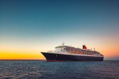 Cunard Line RMS Queen Mary 2 flagship. Adelaide, Australia - February 16, 2018: Cunard Line RMS Queen Mary 2 flagship with people on board leaving Outer Harbour Stock Image