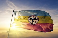 Cundinamarca Department of Colombia flag textile cloth fabric waving on the top sunrise mist fog. Beautiful stock image