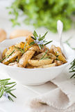 Cunei della patata dei rosmarini Immagine Stock Libera da Diritti