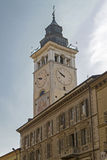 Cuneo. Palazzo della Torre with clock tower in the center of Cuneo Royalty Free Stock Photo