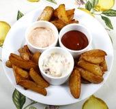 Cunhas de Potatoe Fotos de Stock Royalty Free