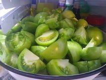 Cunhas verdes do tomate foto de stock