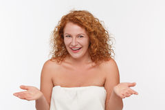 Cunning mature woman. Portrait of cunning mature of middle aged woman inwhite dress posing isolated on white. Red haired lady showing different emotions Stock Image