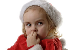 Cunning Santa helper biting his nails. Cute little elf on the withe background Royalty Free Stock Photo